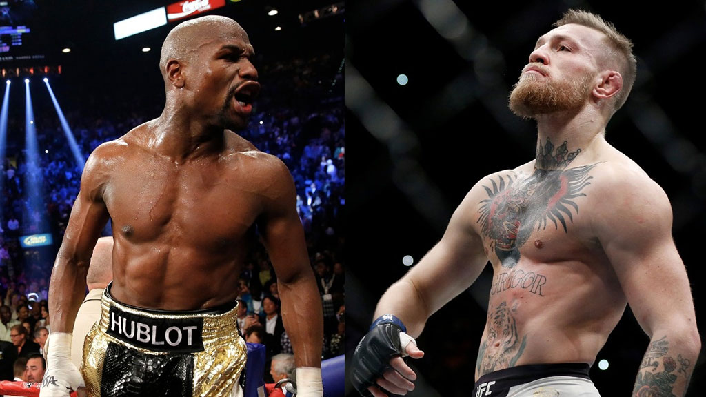 Floyd Mayweather (trái) và Conor McGregor  /// Reuters